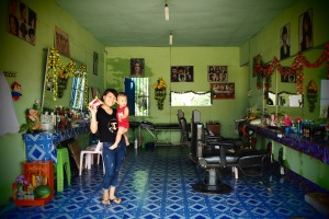 Colorful beauty salon with friendly owner and her son, Pakse