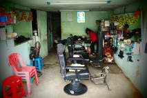 Hairdresser in action near my house, Pakse