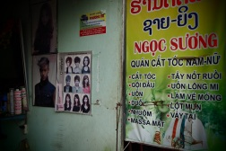 Vietnamese signboard at hair salon in Pakse